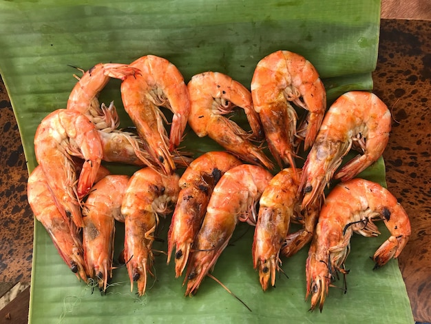 Grilled fresh shrimps on banana leaf dish background