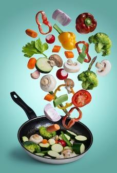 Grilled fresh vegetables flying