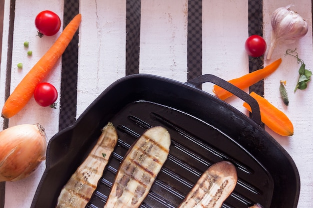 Grilled frying pan and different vegetables