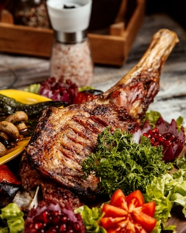 Grilled lamb leg  with vegetables  side view