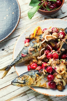 Grilled mackerel fish stuffed with cherries