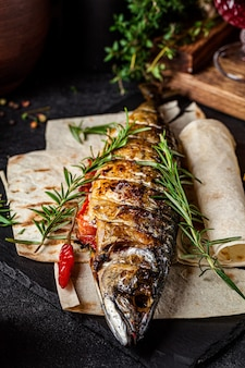 Grilled mackerel fish with vegetables and rosemary