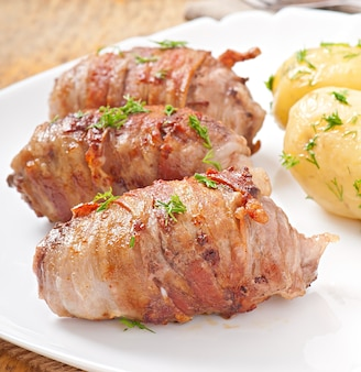 Grilled meat rolls wrapped in strips of bacon