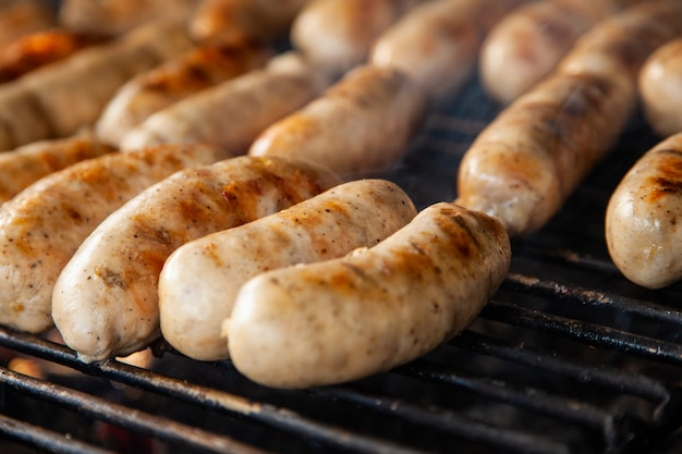Grilled meat sausages on charcoal grill