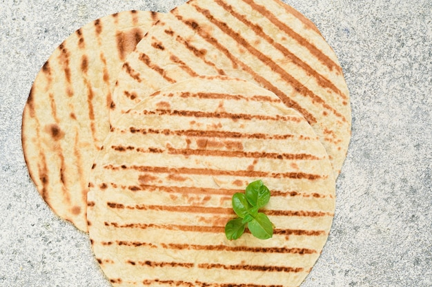 Grilled mexican tortilla on a concrete background. view from above.
