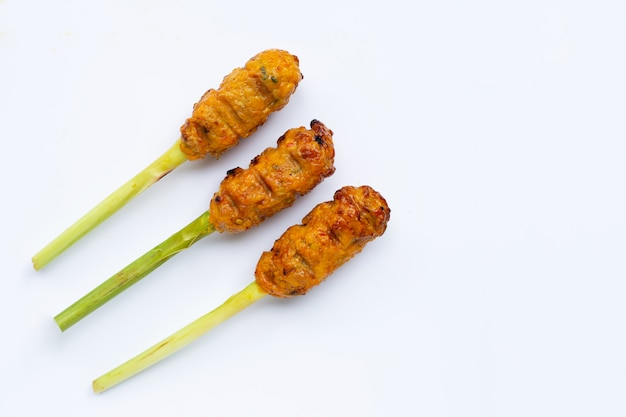 Grilled minced chicken with curry paste and coconut cream on lemongrass skewers.