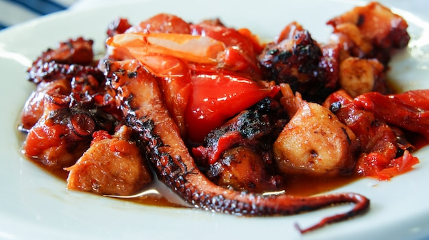 Grilled octopus with sweet peppers in a cafe on the canary islands (pulpo frito)