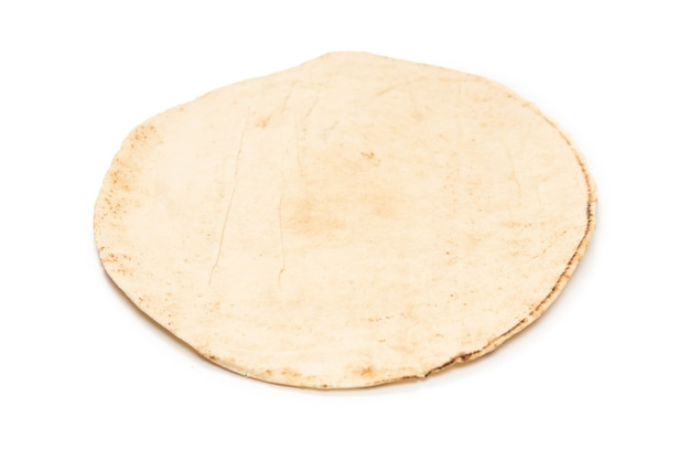 Grilled pitta bread isolated on white surface. top view.