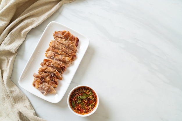 Grilled pork neck or charcoal-boiled pork neck with thai spicy dipping sauce