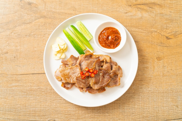 Grilled pork neck sliced on plate in asian style
