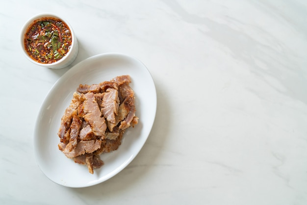 Grilled pork neck with thai spicy dipping sauce