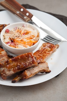 Grilled pork ribs in barbecue sauce.