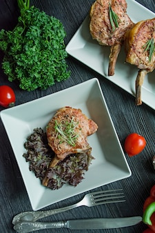 Grilled pork ribs steaks with spices and herbs.