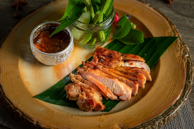 Grilled pork in the wooden board.