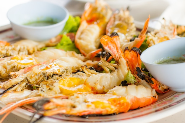 Grilled prawn with spicy sauce close up