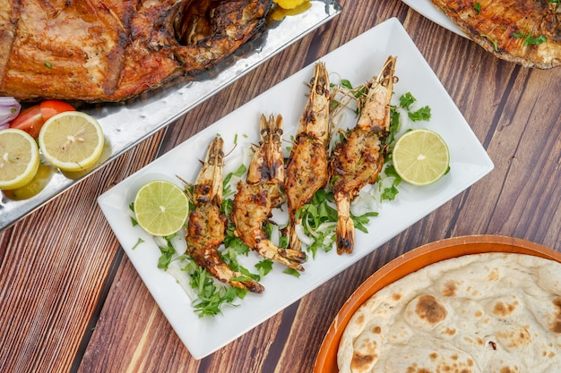 Grilled prawns on a white plate