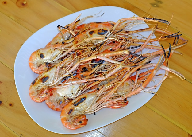 Grilled prawns in white plate