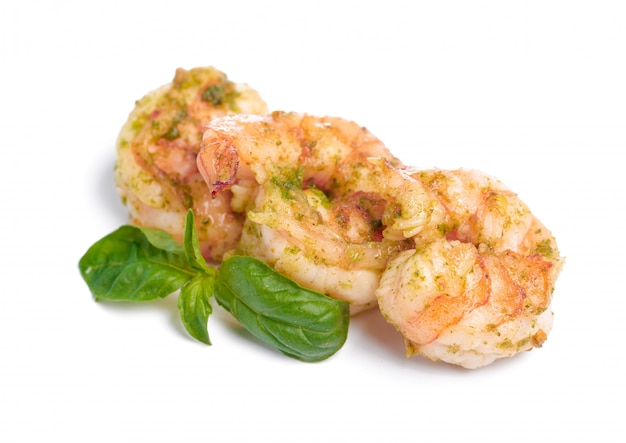 Grilled prawns with basil leaf isolated on white