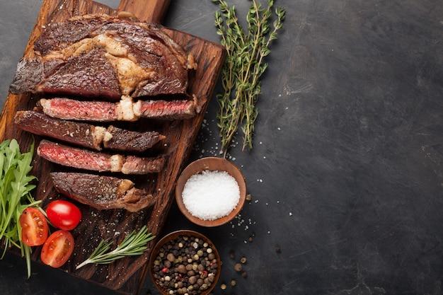 Grilled ribeye beef steak.