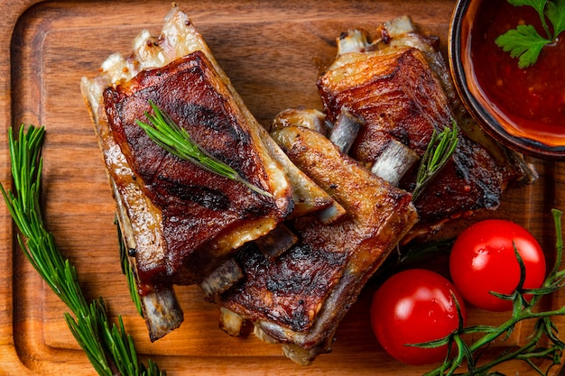 Grilled ribs in barbecue sauce close up. high quality photo