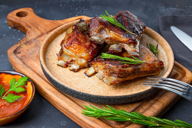 Grilled ribs in barbecue sauce on the plate close up. high quality photo
