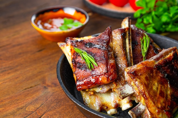 Grilled ribs in barbecue sauce on the table close up. high quality photo