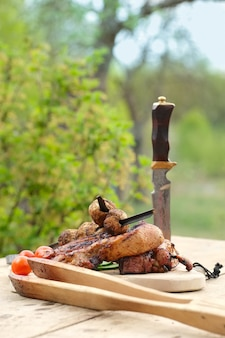 Grilled ribs and champignon on skewer