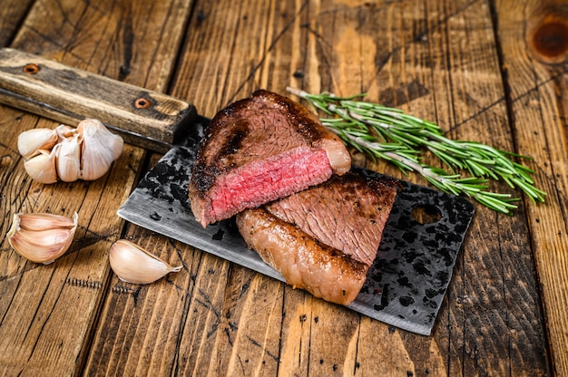 Grilled rump cap or brazilian picanha beef meat steak on a cleaver.