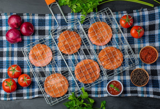 Grilled salami slices. grill grid over wooden table with vegetable.