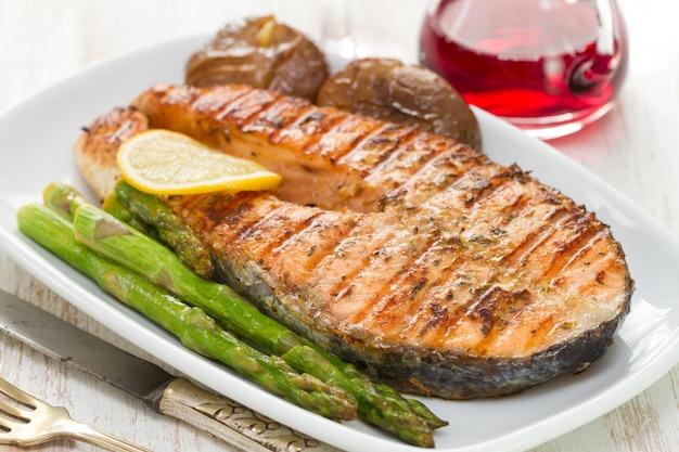 Grilled salmon asparagus and potato on white dish on white