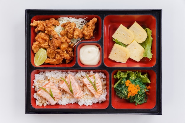 Grilled salmon bento with japanese fried chicken.