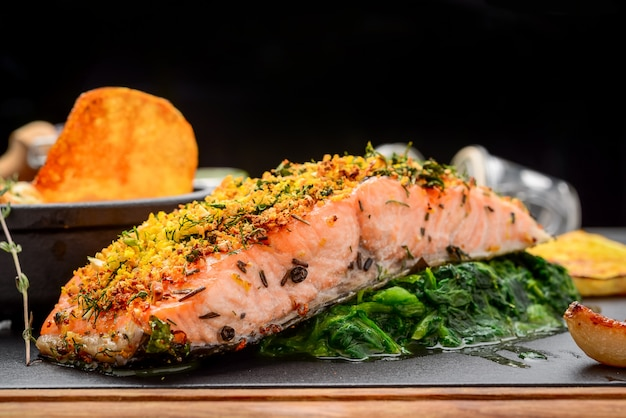 Grilled salmon on cutting board on wooden