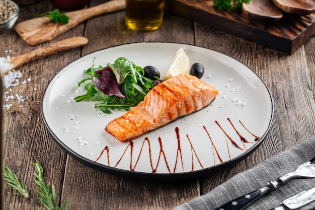 Grilled salmon fillet steak with salad