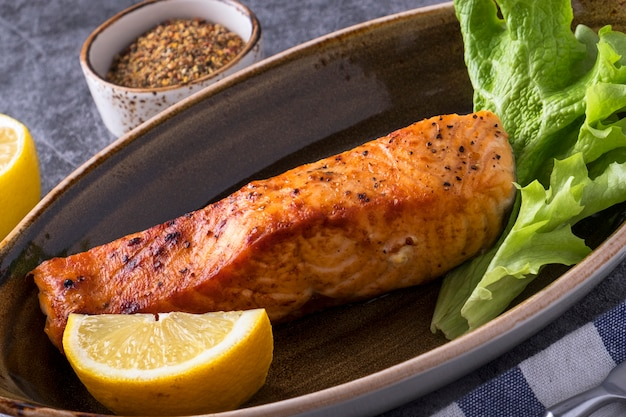 Grilled salmon  lemon on a plate