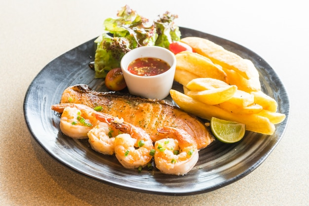 Grilled salmon and prawn steak