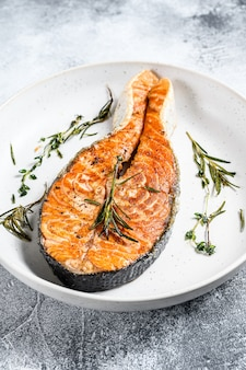 Grilled salmon steak. atlantic fish. gray background. top view