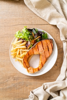 Grilled salmon steak fillet with vegetable and french fries