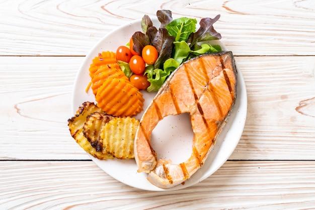 Grilled salmon steak fillet with vegetable