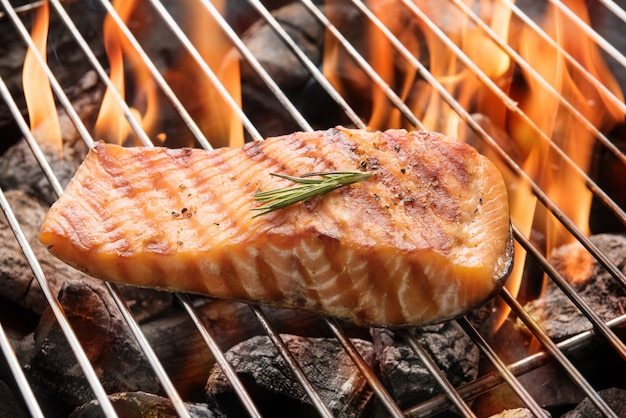 Grilled salmon steak on the flaming