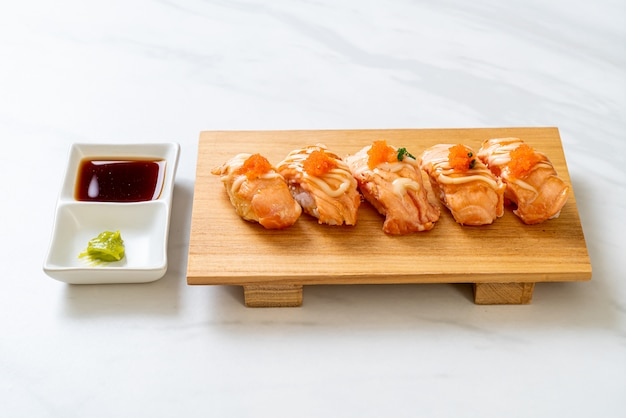 Grilled salmon sushi on plate