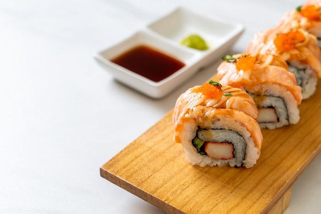 Grilled salmon sushi roll with sauce