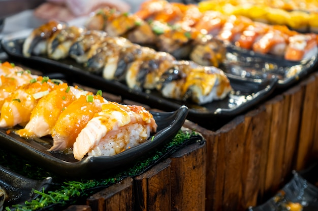 Grilled salmon sushi with sauce. japanese food