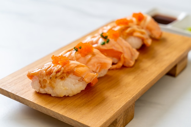 Grilled salmon sushi on wood plate - japanese food style