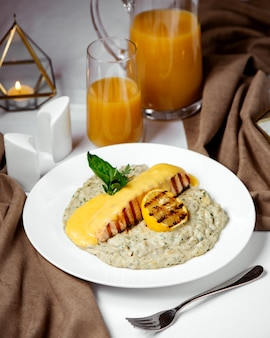 Grilled salmon topped with melted cheese, served with risotto