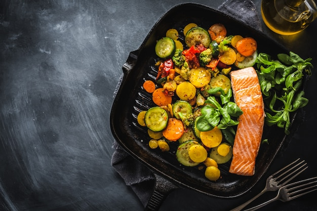 Grilled salmon with vegetables on pan