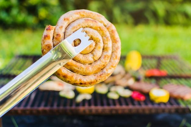 Grilled sausage coil al fresco