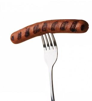 Grilled sausage on a fork