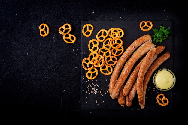 Grilled sausages on dark background. oktoberfest