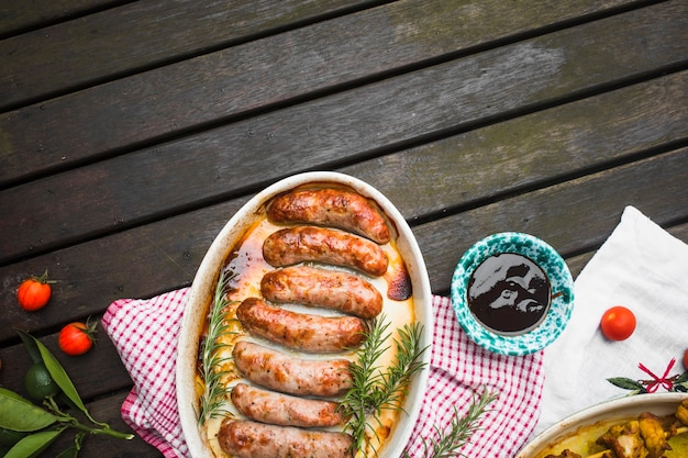 Grilled sausages with sauce and vegetables