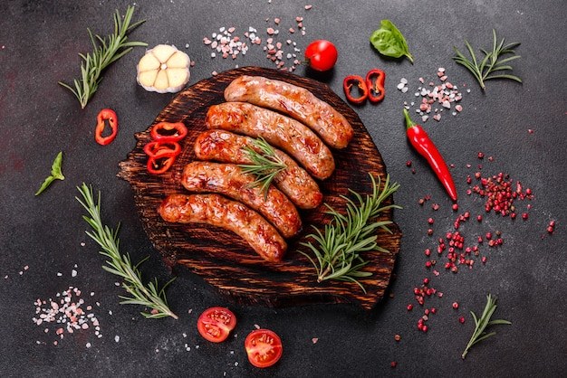 Grilled sausages with vegetables and spices